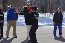 Civilians being taught basic firearms drills during the KAPAP Level 1 instructor course USA