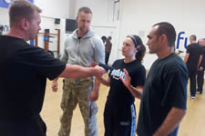 Jude Turley female KAPAP UK instructor training at the KAPAP Great Yarmouth level1, practicing pistol disarms