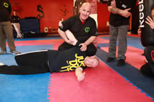 Sam Markey demonstrating a side control with armbar. I love the just do it on the t-shirt